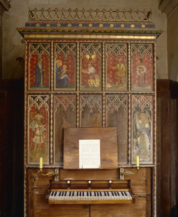 Organ decorated with painted panels depicting religious figures, in the Parish Church of All Saints at Great Chalfield Manor, near Melksham, Wiltshire