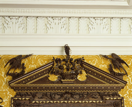 Partial view of the Rococo chimneypiece and overmantel dating from c.1760, in the Dining Room at Hanbury Hall, Worcestershire.
