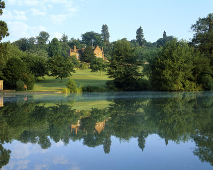 A view at dawn across the lake of the house at Chartwell, Kent, the family home of Sir Winston Churchill from 1922 until 1965