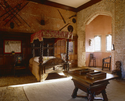 The King's Room at Oxburgh Hall, King's Lynn, Norfolk, showing the four-poster bed dated 1675 and the bay window