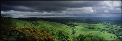 Stormy skies over the Blackmore Vale from Melbury Hill (NT) near Shaftesbury, Dorset