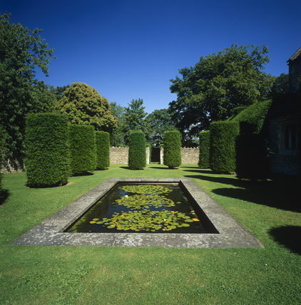 The Lily-pond in the garden of Westwood Manor, surrounded by clipped trees forming sentinels