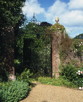 The wrought iron gate in the brick wall leading to the Pool Garden at Peckover House