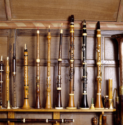 Detail of flageolets, oboes & clarinets, c.1800-1820, displayed on a shelf in the Music Room at Snowshill Manor.