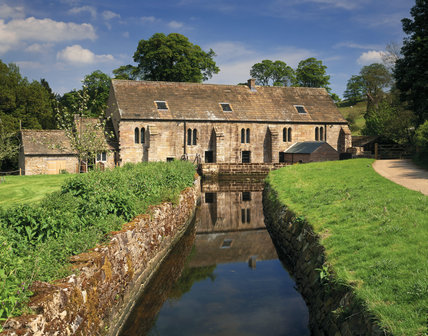 Fountains Mill the finest surviving example of a monastic water mill 800 years old, west front showing the former mill race