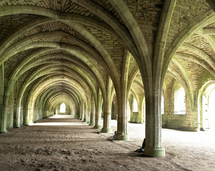 An interior view of the Lay Brothers Refectory inside Fountains Abbey