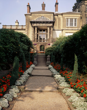 The Italian Garden with its stepped terrace and balustrades and the west end of the house at Biddulph Grange in Staffordshire