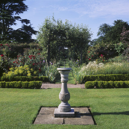 View of the walled garden at Gunby Hall planted with traditional English vegetables, fruit and flowers, showing a sundial in the foreground