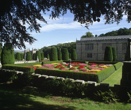 View of the colourful plantings in the geometric parterre in the garden at Lanhydrock