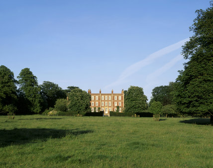 View of the entrance front of Gunby Hall from the park