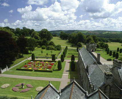 View from above showing the colourful geometric parterre and the church border in the garden at Lanhydrock taken from the Church tower