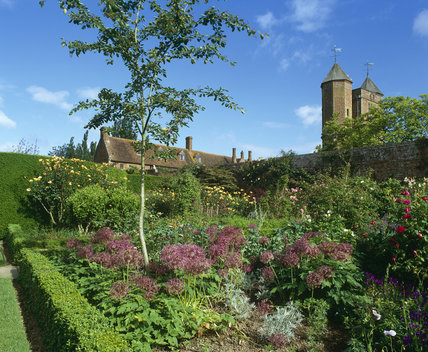 A view of the Rose Garden at Sissinghurst Castle Garden taken in June, with the Elizabethan tower behind