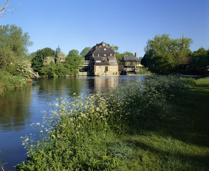 Looking along the river to Houghton Mill, a large timber-built watermill, on an island in the Great Ouse