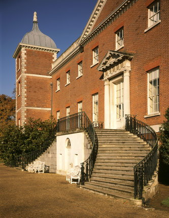 Close view of the C18th west front of Osterley, showing the doorway with a pediment added at a later date, and the circular stairway leading up to the door