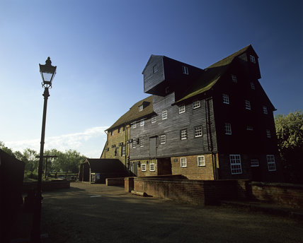 Houghton Mill, a large timber-built watermill, on an island, in the Great Ouse