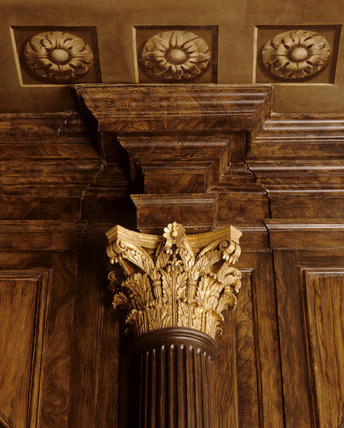 Detail of the top part of the grained wooden column and part of the trompe l'oeil ceiling in the Hall at Hanbury Hall, Worcestershire