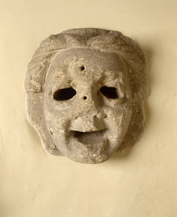 A stone looking-mask squint in the Hall Gallery at Great Chalfield Manor, near Melksham, Wiltshire