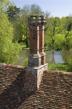 Distinctive chimneys photographed from the top of the Gatehouse Tower at Ightham Mote, Sevenoaks, Kent, a fourteenth-century moated manor house