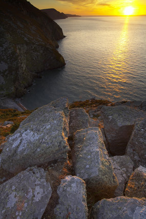 Dramatic lighting in late summer on the cliff tops of Highveer Point, above Heddon's Mouth near Lynton, looking along the North Devon coast, at sunset