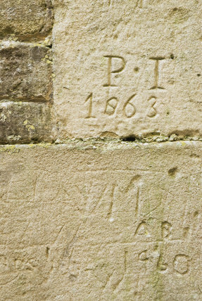 Ancient graffiti etched into the walls of Lyveden New Bield, Peterborough, Northamptonshire