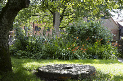 An old millstone in the garden at Winchester City Mill, Hampshire