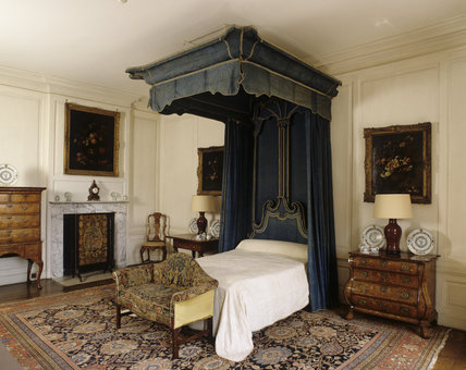 The Blue Bedroom at Hanbury Hall, Worcestershire, looking towards the early eighteenth-century angel bed, and the fireplace