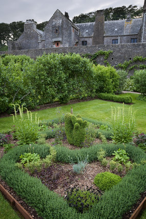 The Knot Garden with planting arranged in a heart shape at Compton Castle, Devon