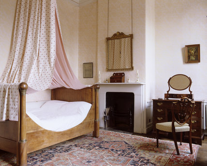 The Governess's Bedroom at Hanbury Hall, Worcestershire, looking towards the bed and fireplace
