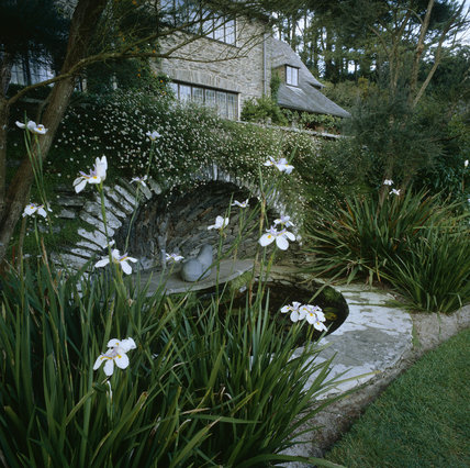 Cool planting around the pool at  Coleton Fishacre, the Arts & Crafts-style house designed in 1925 for Rupert and Lady Dorothy D'Oyly Carte, at Kingswear, Devon