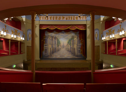 View towards the stage and safety curtain at the Theatre Royal, Bury St Edmunds, Suffolk