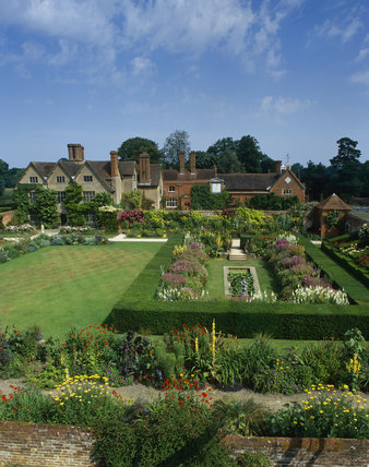A view over the Sunken Garden towards the house at Packwood House, Warwickshire
