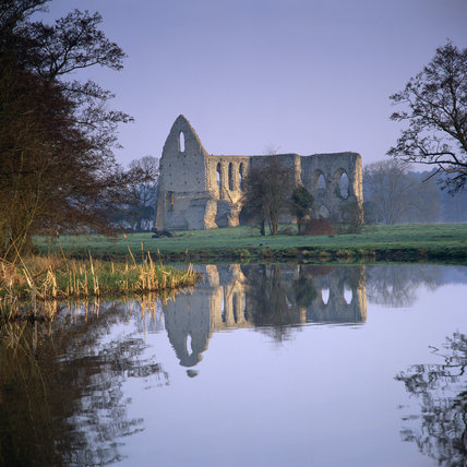 Newark Priory ruins, (Not National Trust), in early morning light on the River Wey Navigations, Surrey