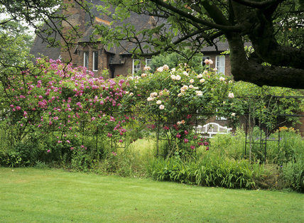 Part of the garden at Red House with a view of the house in the background; built for William Morris in 1859 he lived in the house with his wife Jane between 1860 and 1864