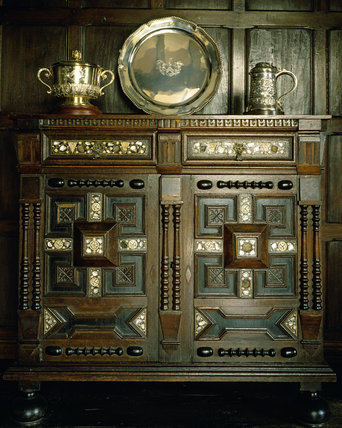 Packwood House, a Charles II oak cupboard inlaid with mother of pearl and decorated with split baluster