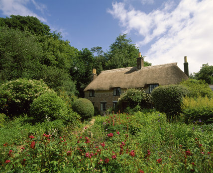 The rear of Thomas Hardy's Cottage, Dorset, seen across the garden