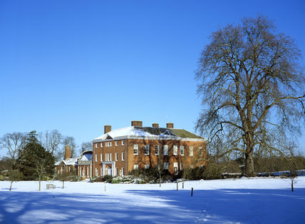 A view of the House at Hatchlands, seen across the snowy ground