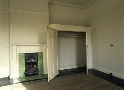 Upstairs bedroom (during conservation) at Llanerchaeron, a Nash house designed in the 1790's, showing old wallpaper (inside wardrobe) and new (outside)