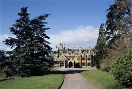 Medium view of East Front of Tyntesfield showing path leading through the lawn to the Gothic style house, remodelled by architect John Lawton 1863-1866