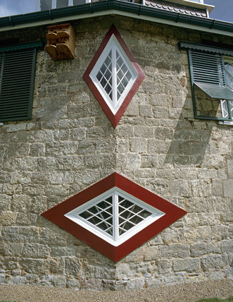 Close-up of two diamond shape windows installed in A la Ronde