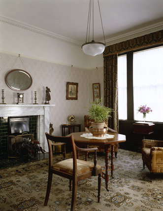 The Morning Room at Llanerchaeron looking towards the fireplace and window, the room was remodelled in the 1920s, the chairs are upholstered in a 'Jazz Age' cut cotton-velvet of the 1930s