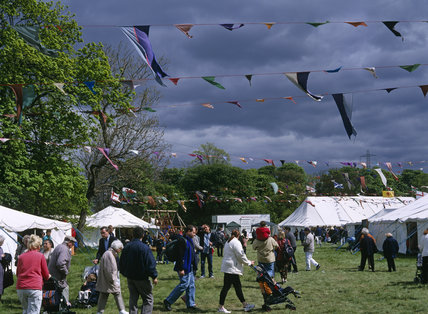 Visitors to a Countryside and Craft Fair at Morden Hall Park in the London suburb of Merton