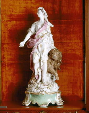Close view of Chelsea porcelain figure of Una and the Lion, depicting Truth, a principal character in Spenser's allegorical poem The Faerie Queene, on the Landing at Upton House