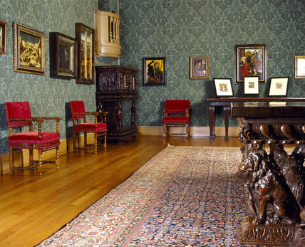 The Picture Gallery at Upton House with C15th and C16th paintings and C16th Italian walnut dining table and furniture