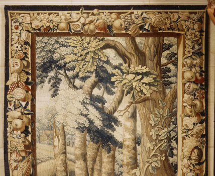 Detail of Brussels tapestry showing border pattern of flowers and fruit, part of seven mid-C17th tapestries woven in wool and silk depicting boar and stag hunts, in the Hall at Upton House
