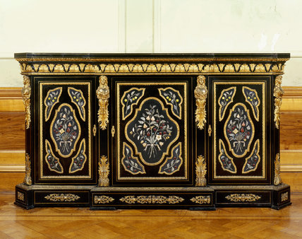 Close view of an ebony cabinet decorated with pietra dura and gilt bronze mounts dating from the late nineteenth century in the Drawing Room at Dunster Castle