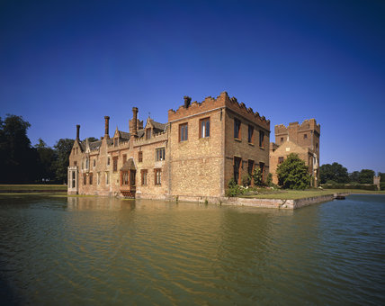 The south west corner of Oxburgh Hall seen from across the moat