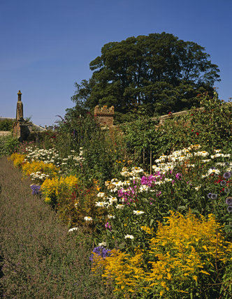 A colourful herbaceous border in the garden at Oxburgh Hall