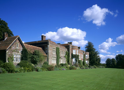 The South front of Hinton Ampner with the lawn and flower border