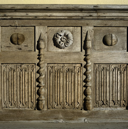 Detail of the carved back of a wooden bench in the Entrance Porch in the east front