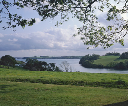 Looking out over a ha ha in the grounds at Trelissick to the Fal estuary beyond